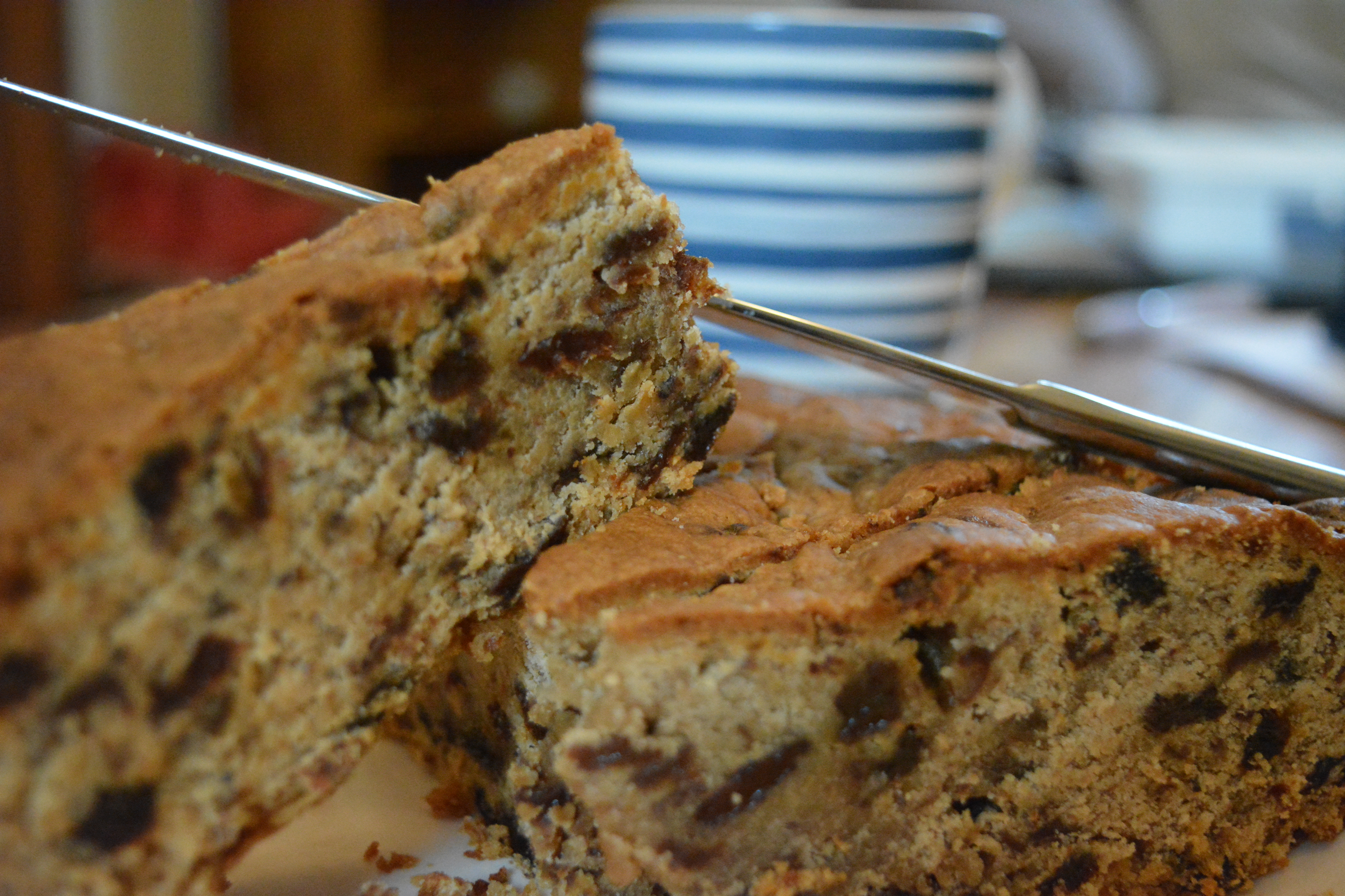 Two slices of Spiced Sultana Cake stacked upon each other